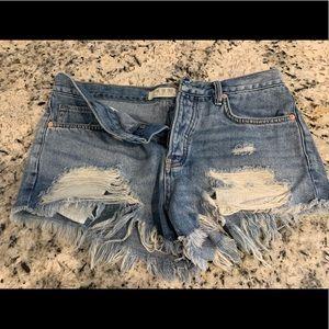Jean cut-off short.